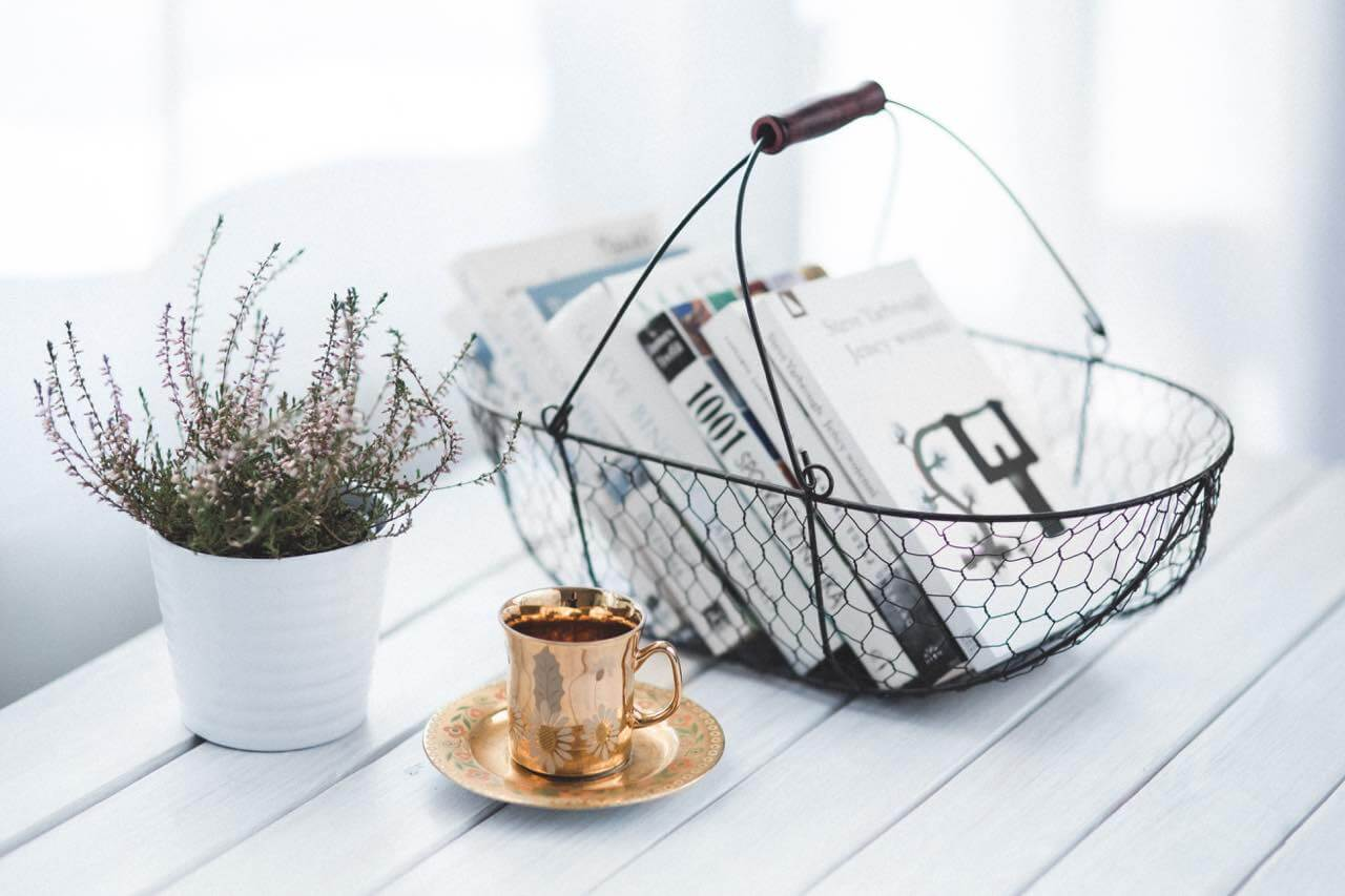 kaboompics.com_golden cup and basket with books